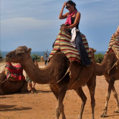 Me riding a camel in Morocco