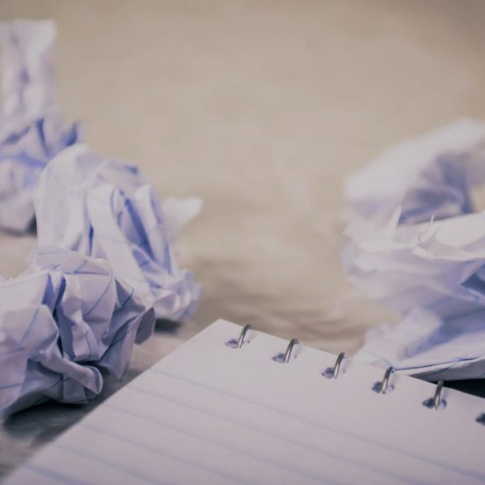 writer's block crumpled up paper ball